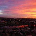 View of town lake at sunset.
