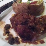 Smothered sirloin with baked potato