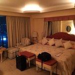 Large comfy master bed in elegant master suite
