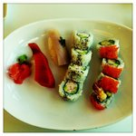 Combo A - California Roll, a Tempura Roll, one piece of Salmon Nigiri Sushi, one piece of Tuna N