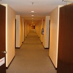 Long hotel corridor, you hate this when you're already tired of walking in the theme park