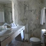 Marble tiled bathroom with plenty of counter space, BIG fluffy towels and even washcloths!