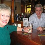 My wife, Betty, with owner John in pub