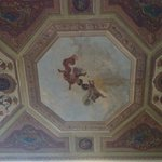 Ceiling mural over bed