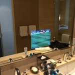 Bathroom with TV in the mirror!