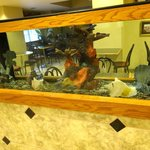 View of the dining area through lobby fish tank