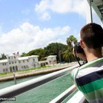 Taking a picture of the Scarface house on the Boat Tour