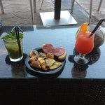 Passion fruit mojito, paradise punch and free tapas! Yummy