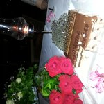 red roses , candles and yummy cake !