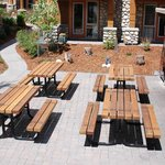 Picnic tables near gas BBQ grills