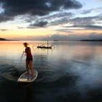 Paddle-boarding at sunset