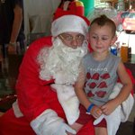 Santa came to visit at the pavilion during Christmas in July.