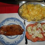 Black pork tenderloin, chips, tomatoe cucumber salad