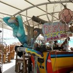 """Cute beach bar to sit and watch the planes fly in and the brave """"ride the fence."""""""