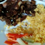 Grilled pork chop with fried rice and steamed vegetables