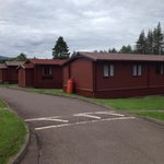 Woodbury lodges with veranda looking on camping and lochy river
