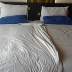 This is how the bed was made up each day.  Lucky we took our own blue pillows!