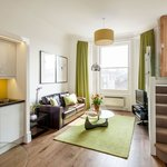Light and bright open plan living with a separate comfortable bedroom