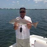 Captain Charlie and a red fish