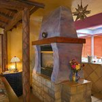 The double sided fireplace in our Classic Spa Room