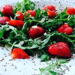 Strawberries salad with grated chocolate & almond flakes