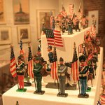 An exhibit of antique flag holders.