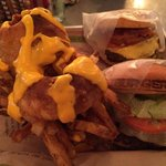 Cry & Fries, onion rings and parmesan topped fries smothered in cheese sauce. Cheeseburger with