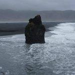 Rock pillar by the beach.