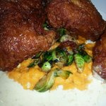 Buttermilk chicken sweet potato puree with roasted brussel sprouts.