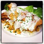 Cornmeal encrusted Sunburst trout, carolina gold rice, cucumber buttermilk sauce.