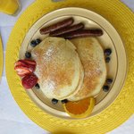 Buttermilk pancakes with blueberries and sausages