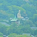 White buddha on the hill as seen from the restaurant