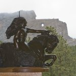 Our view of Crazy Horse behind a replica at guest services.