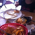 Quesadilla split for two and a side of beans and rice.