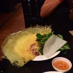 Vietnamese pancake with shrimp and sprouts - rolled into rice paper