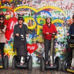 on our segways in front of the john lennon wall