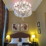 The sleepiing area of our room with beautiful chandelier
