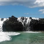 When the waves crash over the rocks, it becomes a waterfall!