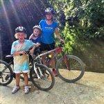 Family mountain bike over the Ser from Mas Pelegri