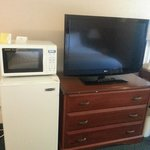 fridge, microwave and flat screen tv