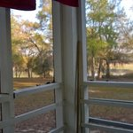 Screened patio with view of lake.
