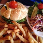 Burger with french fries and salad.