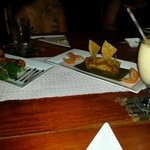 Excellent food - salad, tamal and corn colada