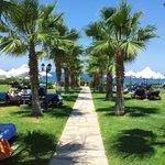 Path through gardens towards private beach.