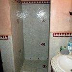 The tiled shower enclosure