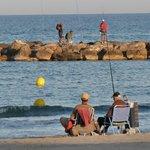 Fischer vor Sonnenuntergang