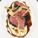 Roast venison loin, braised red cabbage, parsnip puree, chocolate jus