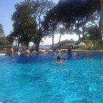 In one of several swimming pools / в одном из бассейнов