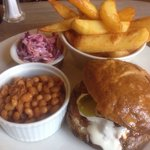 Pulled pork sandwich in toasted brioche bun, sour cream,coleslaw, chunky chips and chilli baked