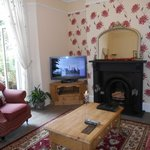 Guest lounge area with French doors to court yard garden & access to castle wall balcony.